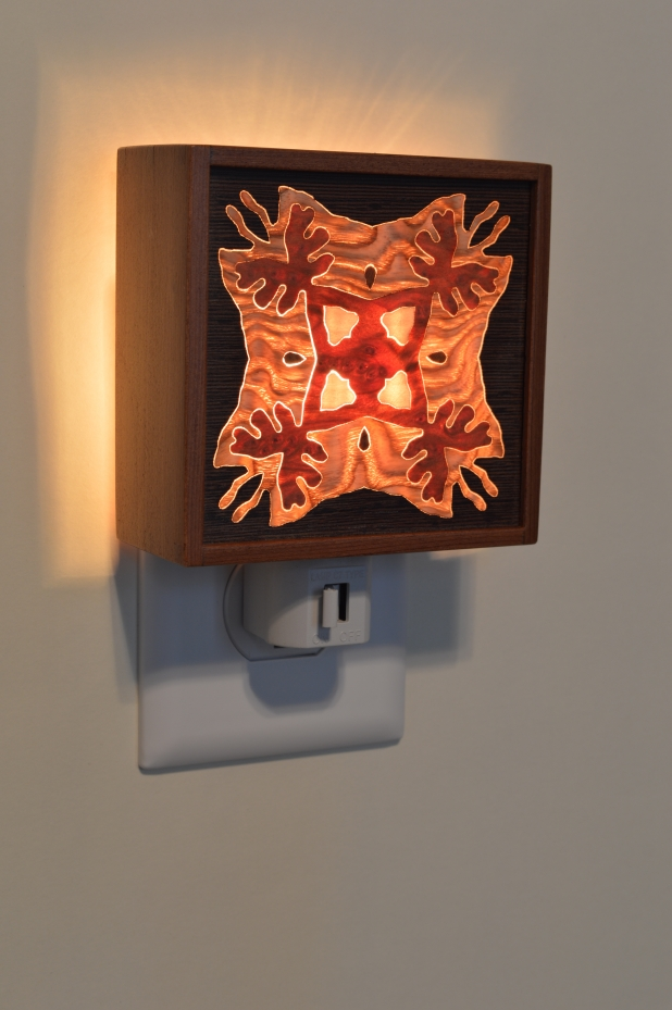 Red Wood nightlight with Bentley Star inlay, lit