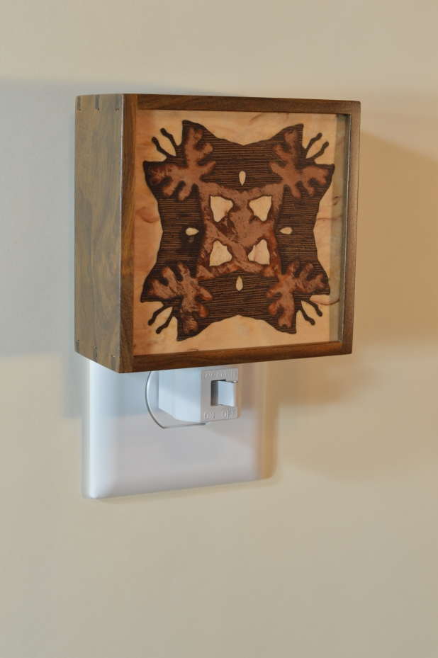 Texas ebony nightlight with Bentley star inlay, unlit. Click to enlarge.