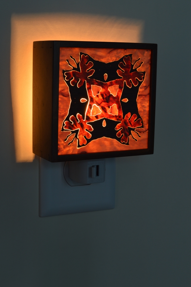 Texas ebony nightlight with Bentley star inlay, lit