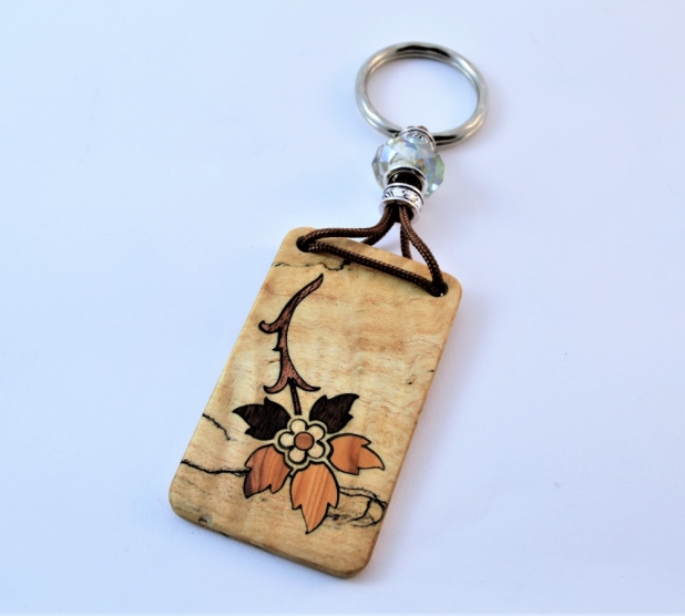 • Victorian Era, Enfache Blume patterned key chain. • Laser cut and hand pieced