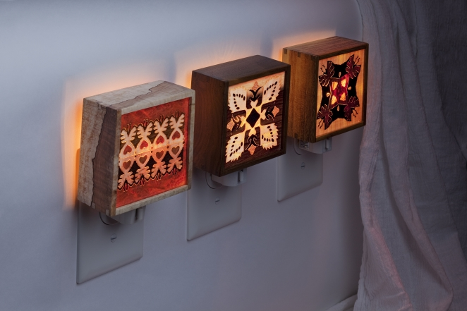 Marquetry nightlights displayed lit.